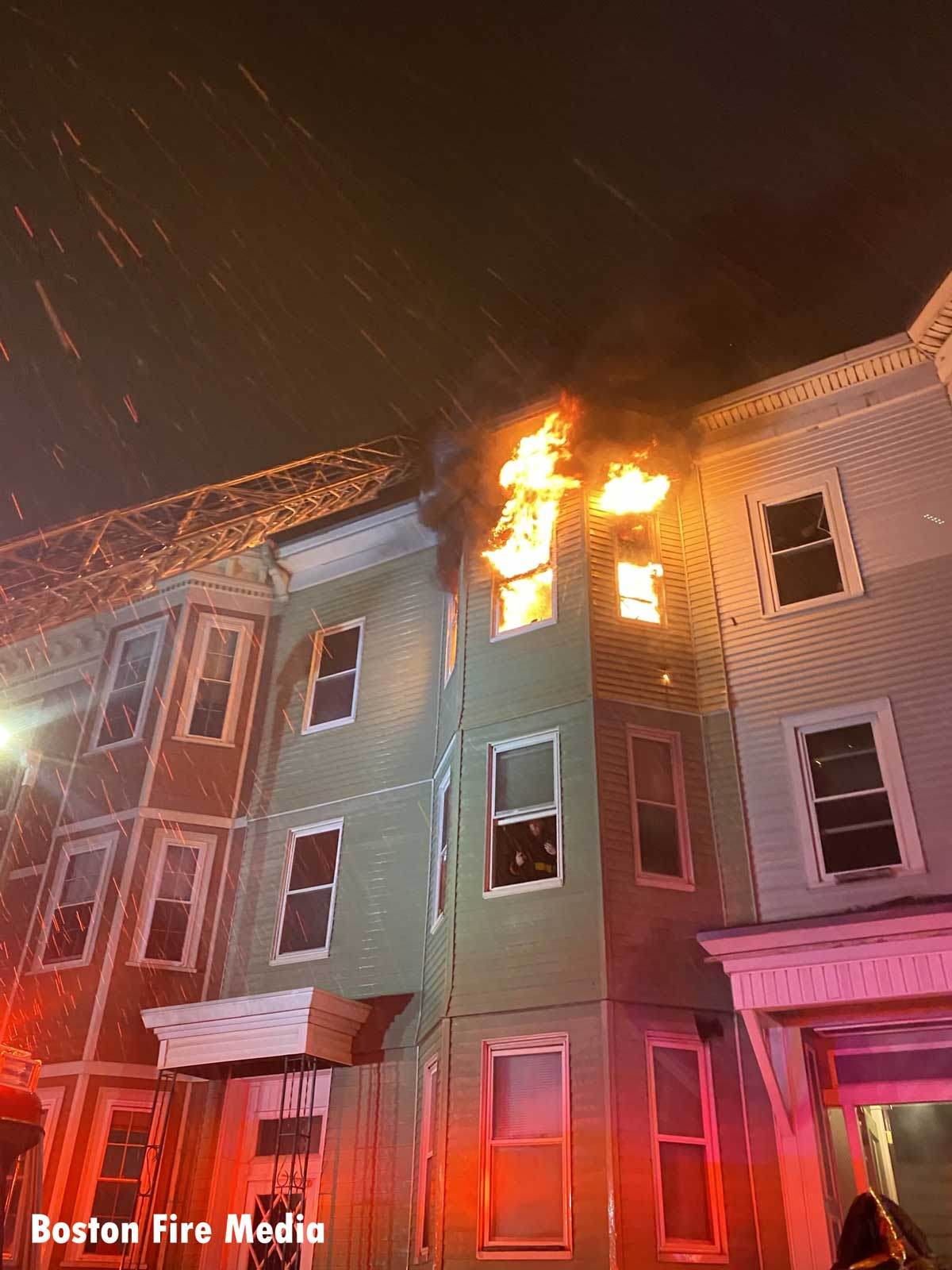 Fire showing from the upper floor of an attached building