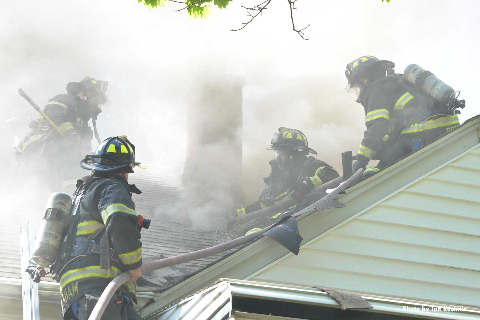 Firefighters performing vertical ventilation