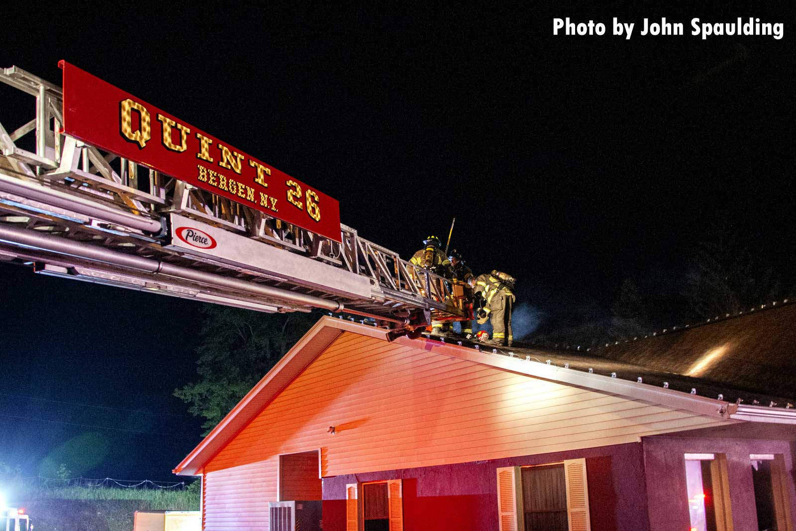 Aerial ladder extended to the fire building