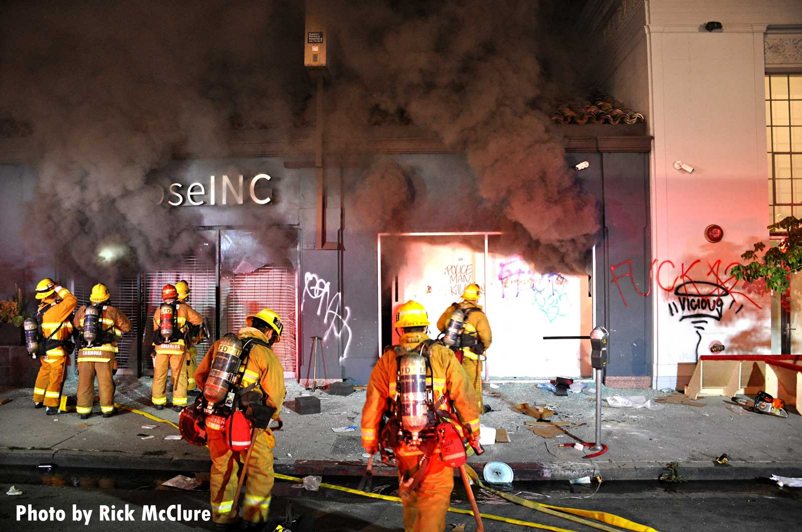 Smoke vents from building as LAFD crews work