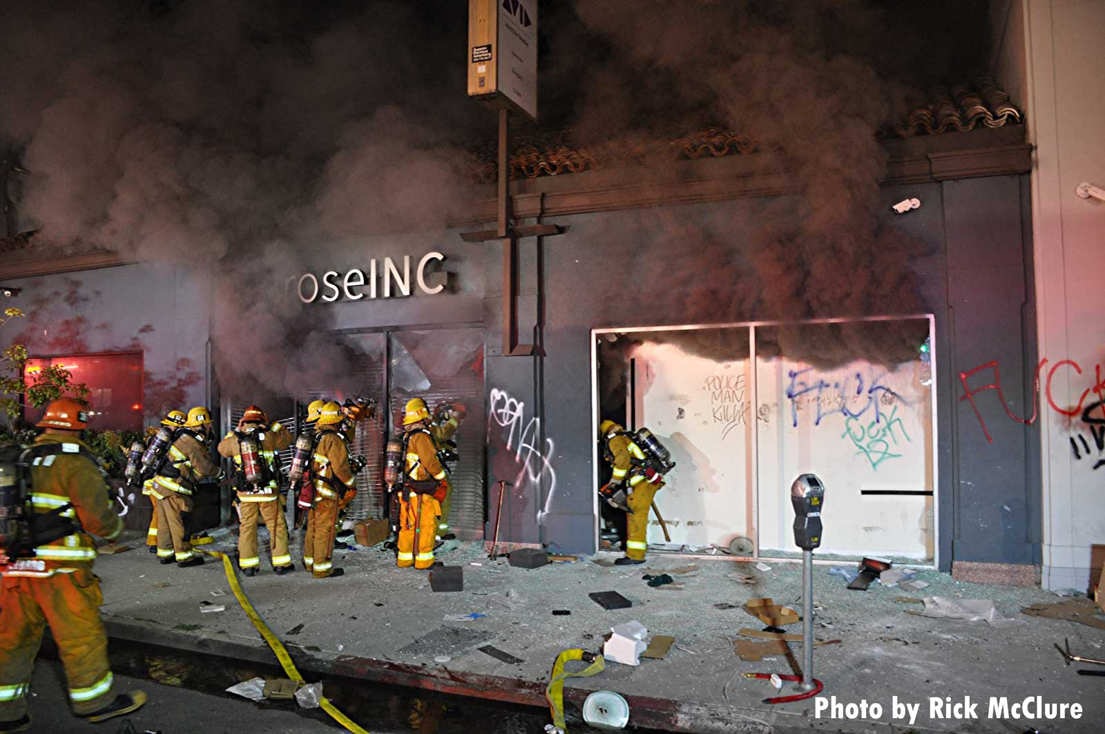 Los Angeles firefighters operate amid smoke