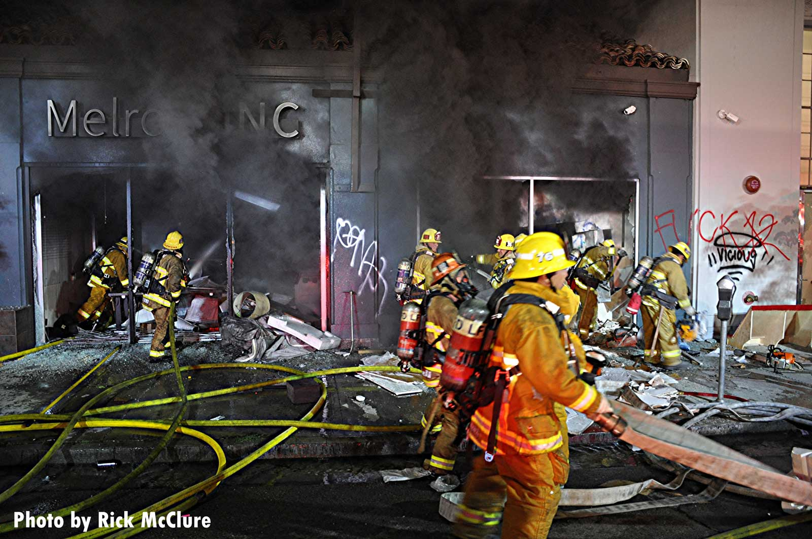 Hoselines and LAFD crew at structure fire