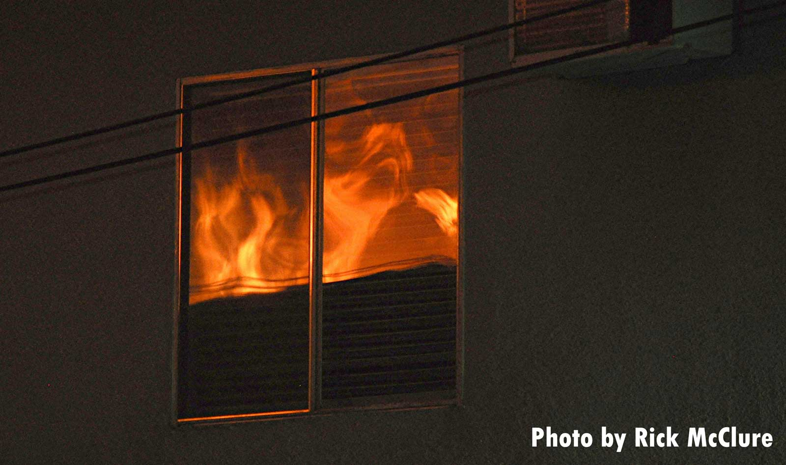 Flames reflect in windows