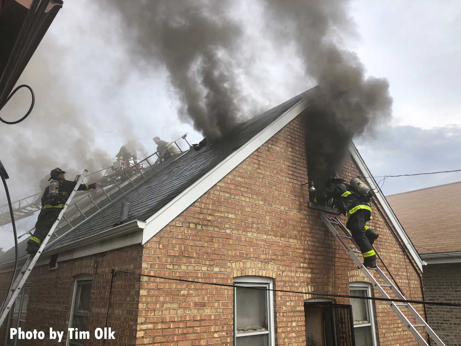 Chicago firefighters work at the scene of a house fire