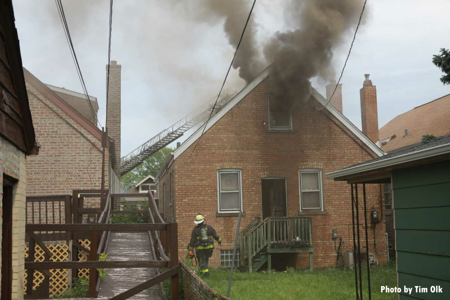 Smoke drifts from a burning home in Chicago