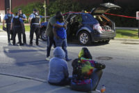 Police and civilians at shooting scene in Chicago