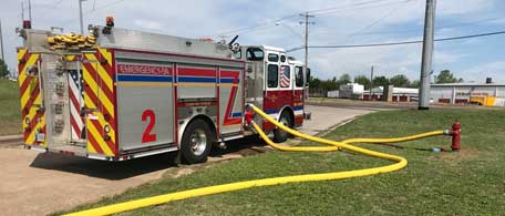 Supply lines run into pumper