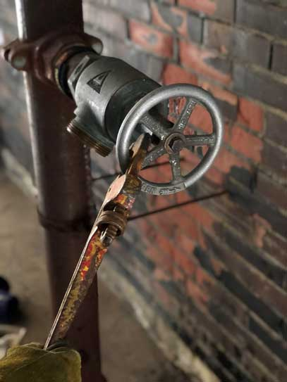 Pipe wrench on standpipe