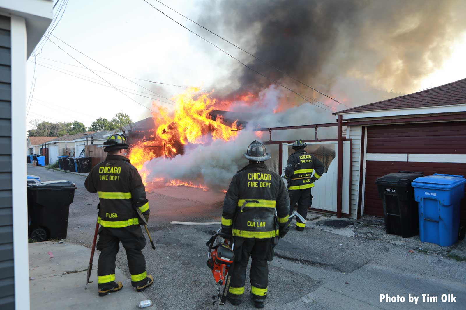 Chicago firefighters apply water to raging fire