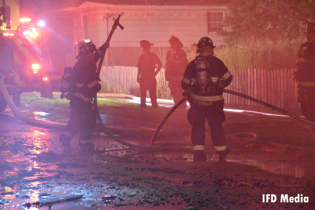 Indianapolis firefighters manage a hoseline