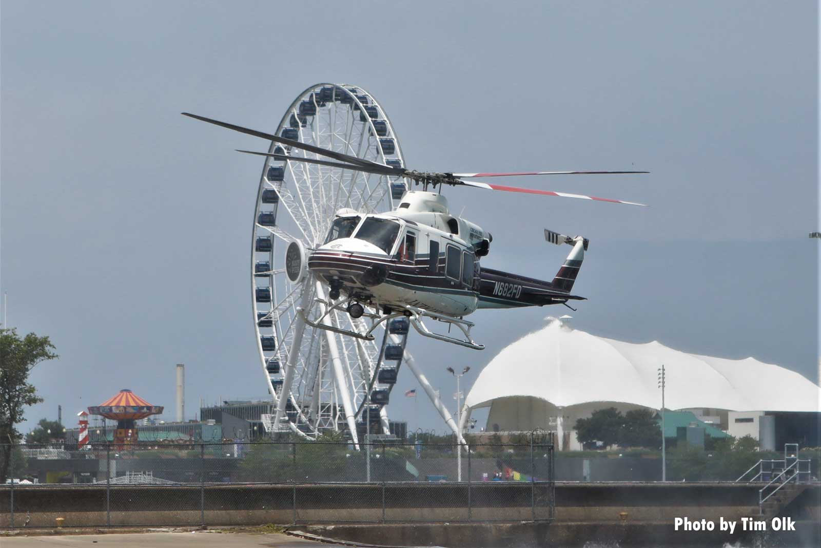 Helicopter with ferris wheel in background