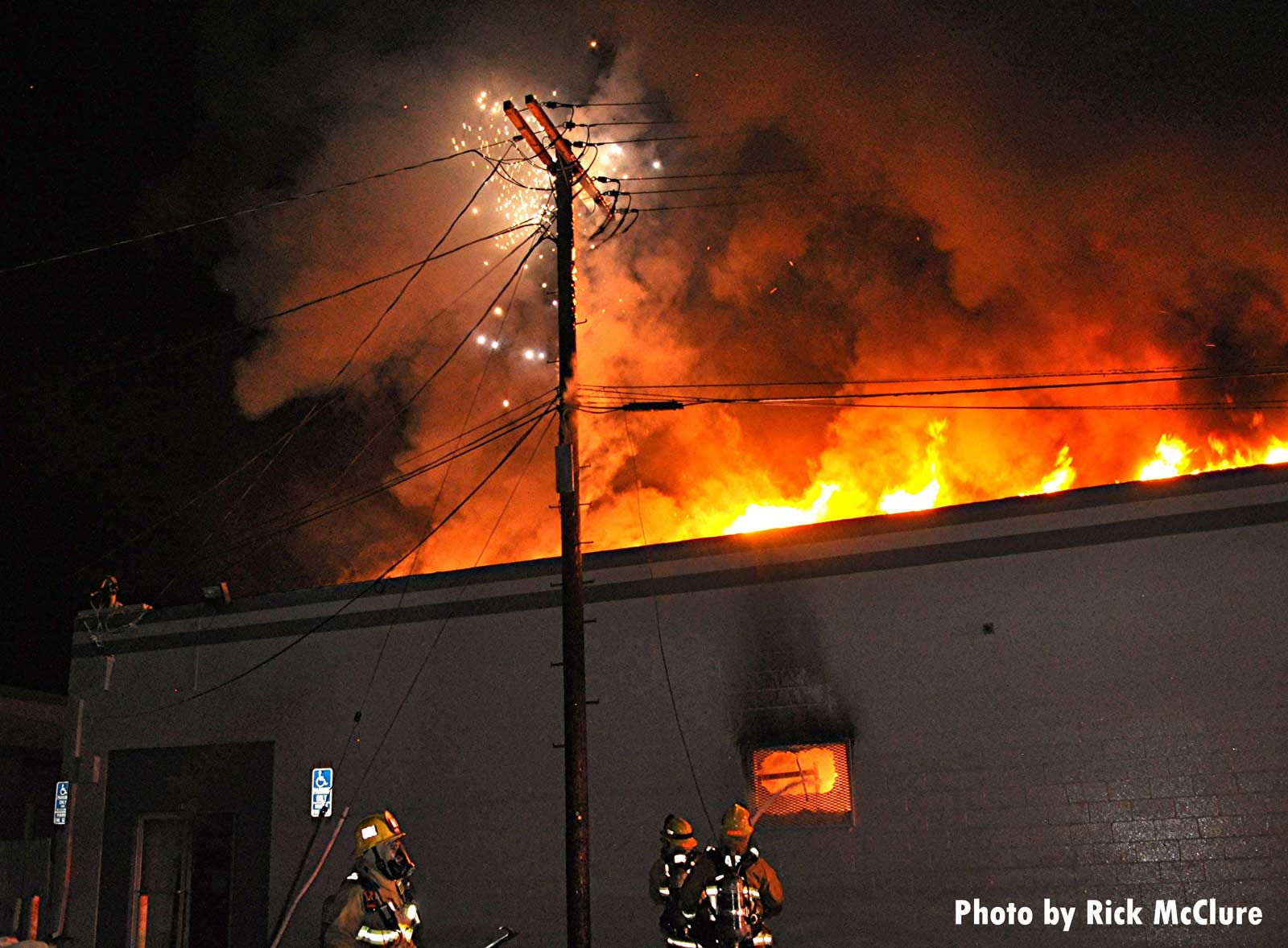 Fire through the roof of the building