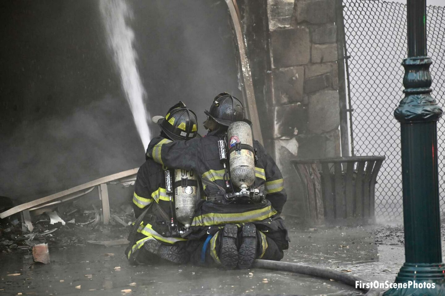 Firefighters on a hoseline at a commercial fire