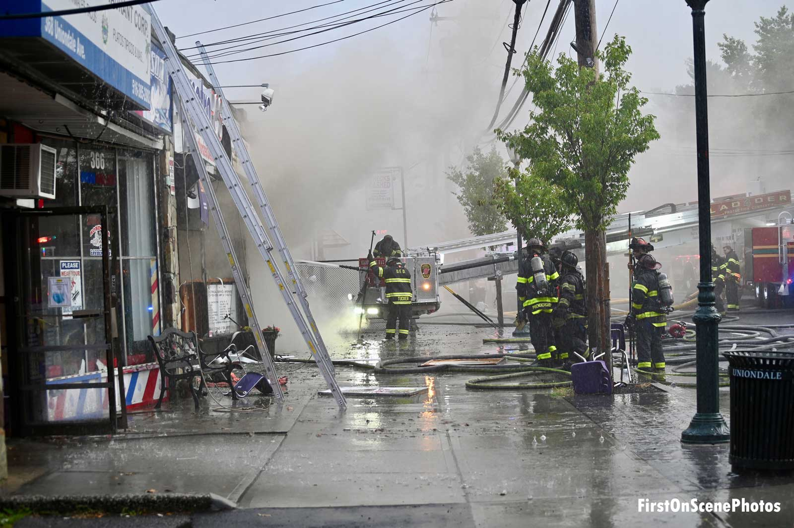 Ladders and firefighters outside a commercial occupancy in Uniondale