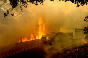 Trailer with fire off road in California