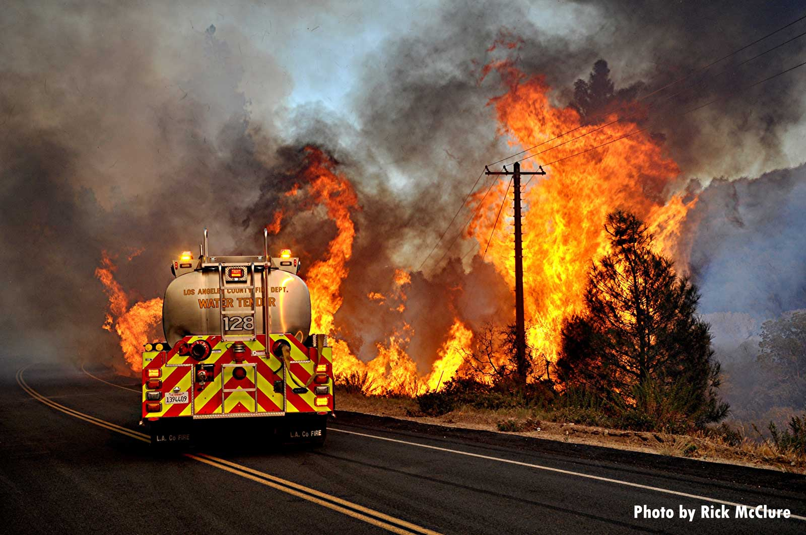 Fire apparatus fights wildland fire from road