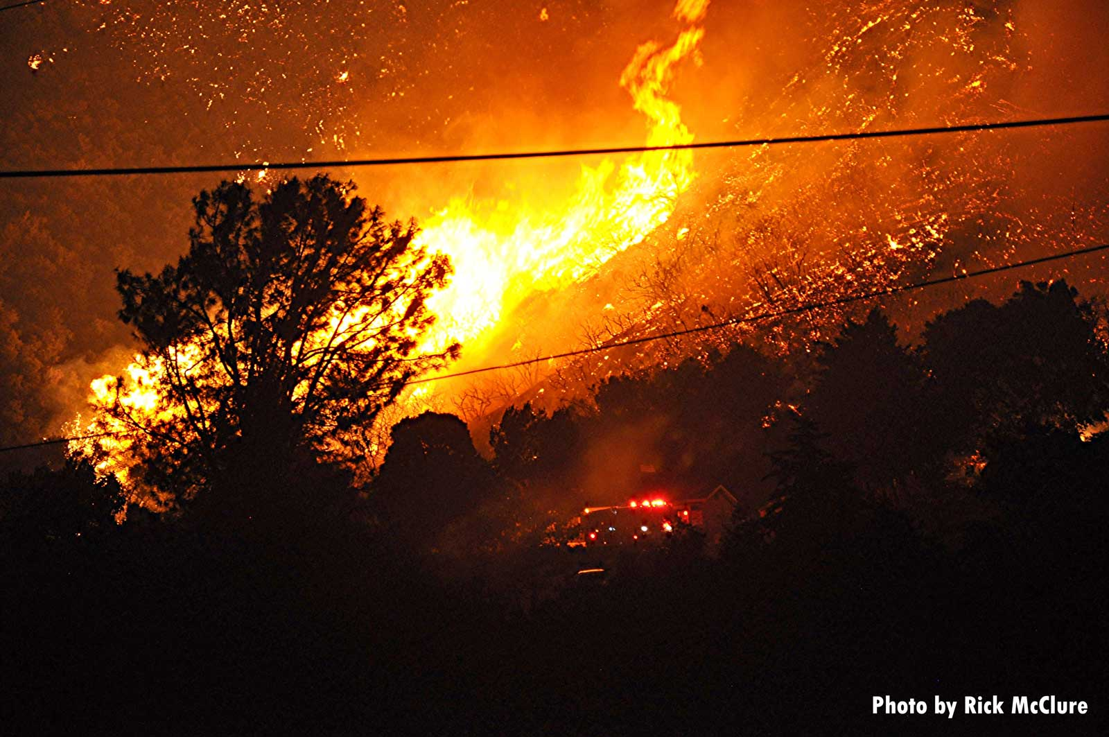 Flames rip through the trees in California