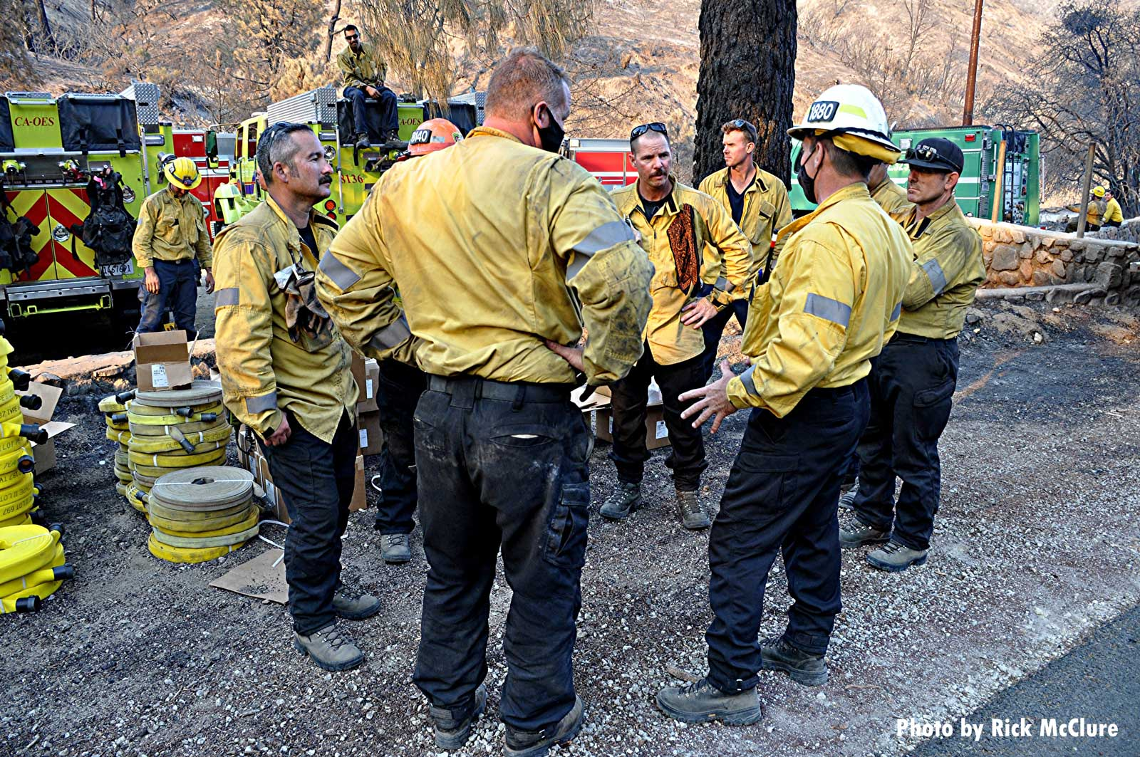 Firefighters confer during Lake Fire in California