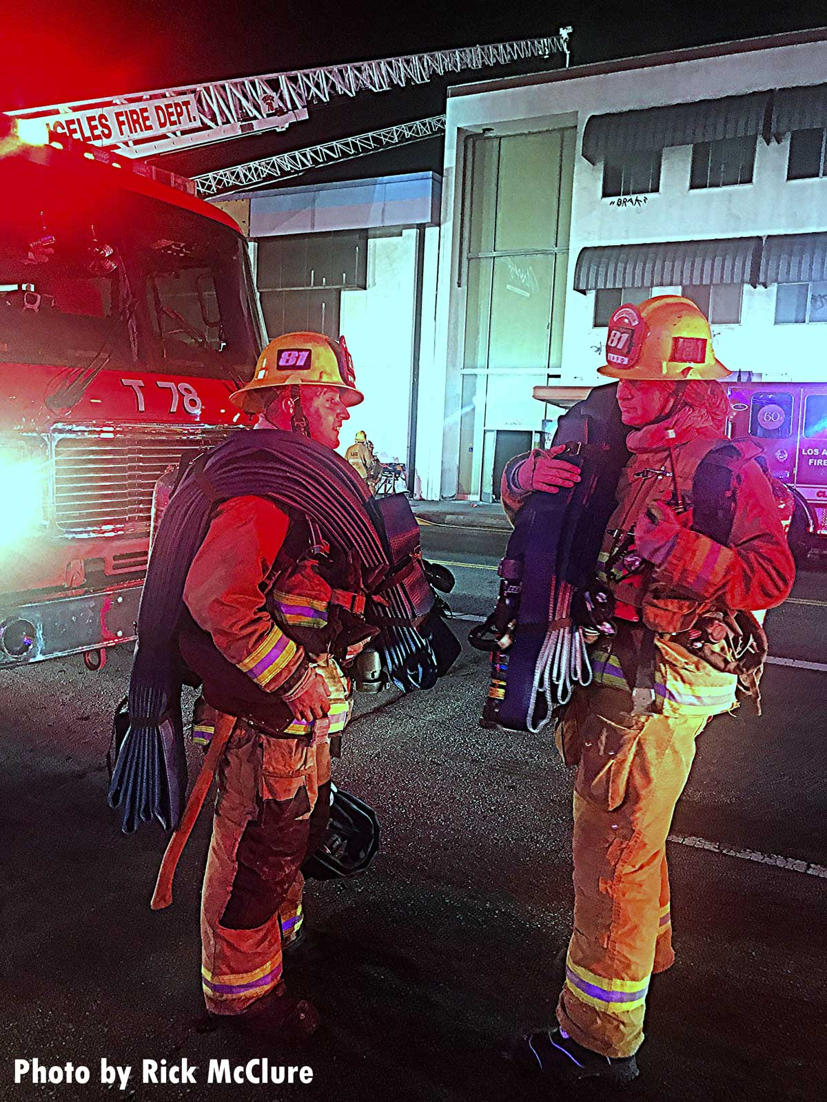 Two Los Angeles firefighters at the fire