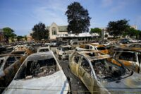 Charred vehicles after unrest