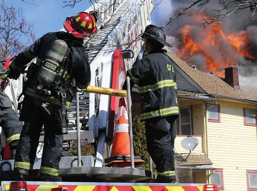 Firefighters stand on aerial device