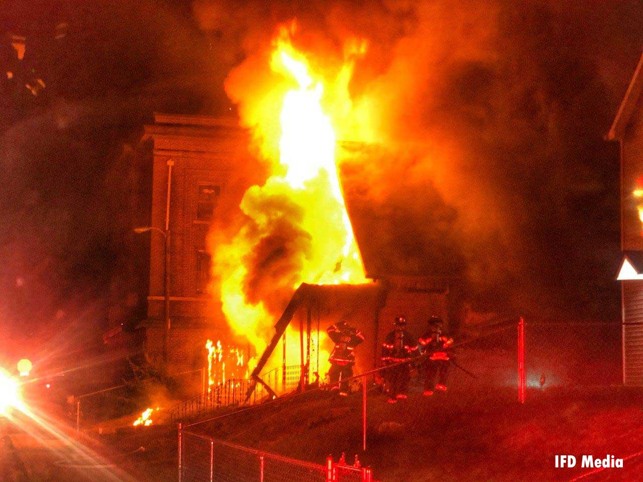 Flames tear through a building in Indianapolis