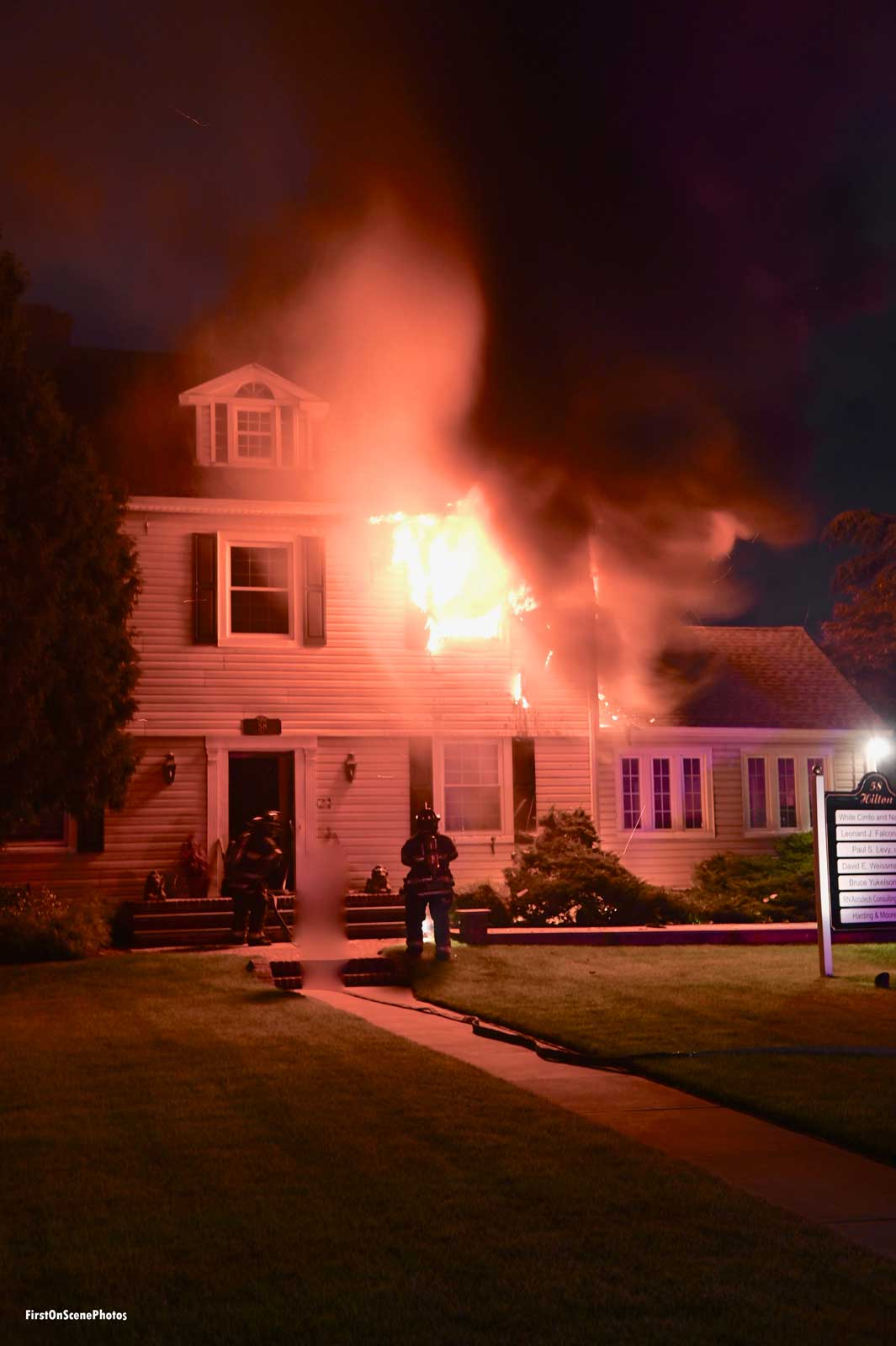 Flames shoot from a home in the village of Hempstead, New York