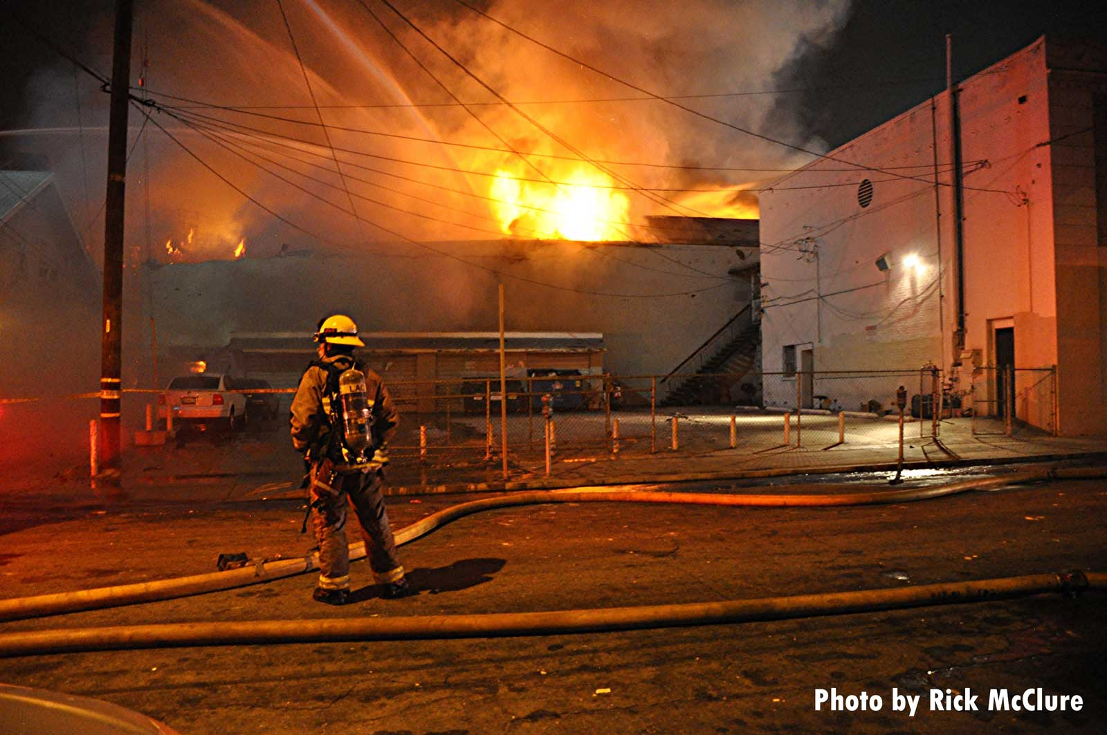 A firefighter at the scene of a raging fire in East L.A.