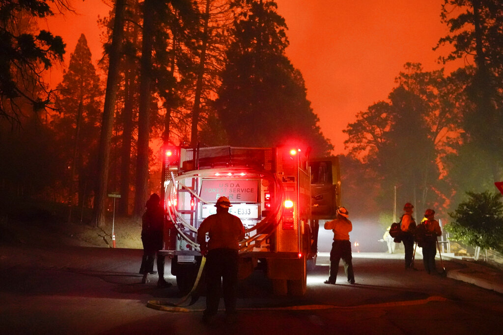 Firefighters stage near a Southern California Edison power station
