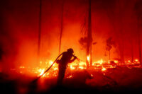 Firefighter battling a 2020 wildfire in California