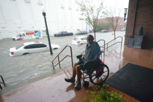 Man in wheelchair with floodwaters from Hurricane Sally