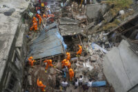 Rescuers work at site of building collapse