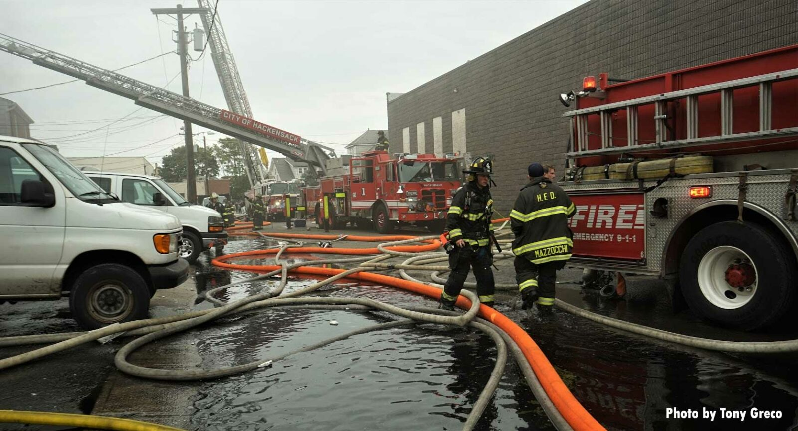 Firefighters and fire apparatus at scene of Hackensack fire