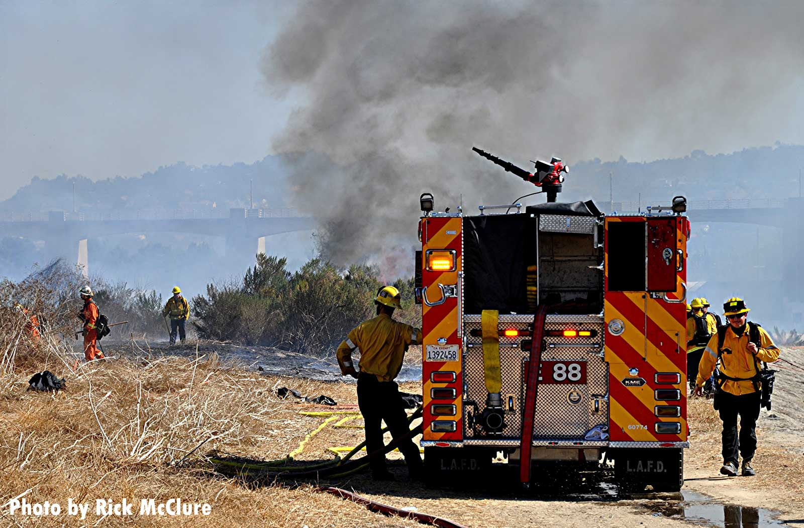 LAFD rig with smoke from vegetation fire in background