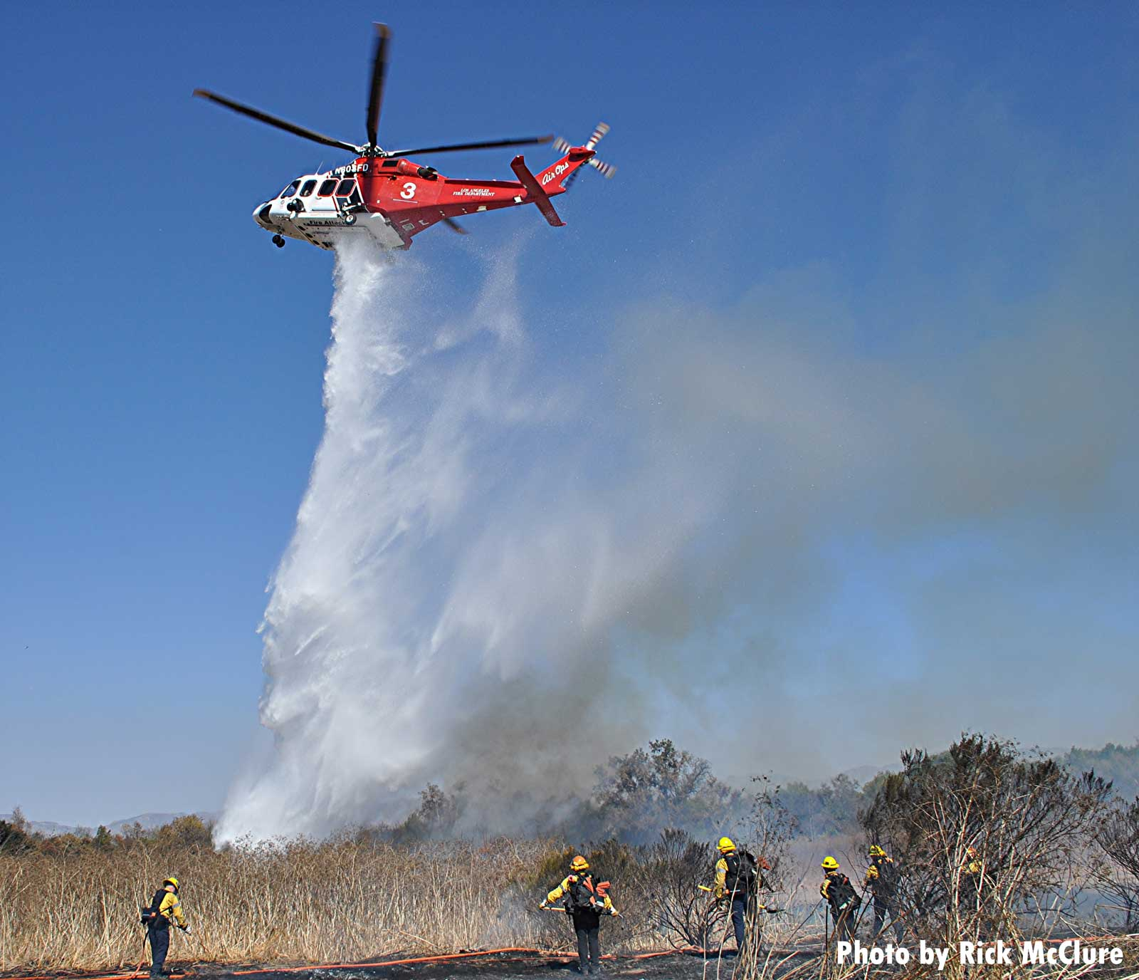 Helicopters makes drop on brush fire