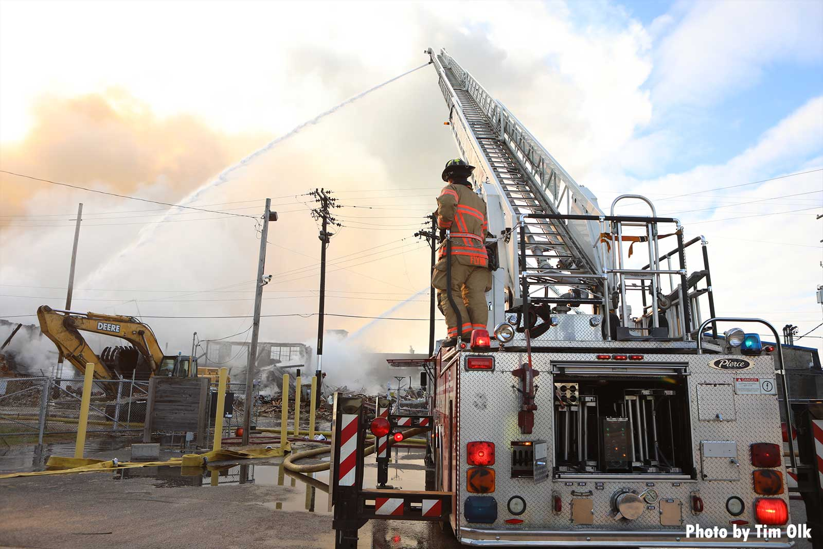 Firefighter on aerial with master stream