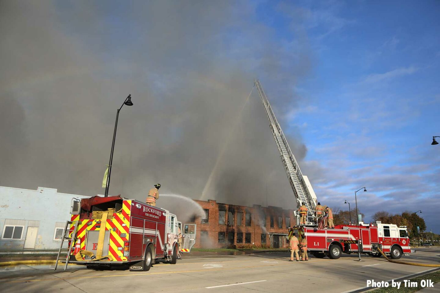 Two apparatus blasting water into abandoned Rockland building
