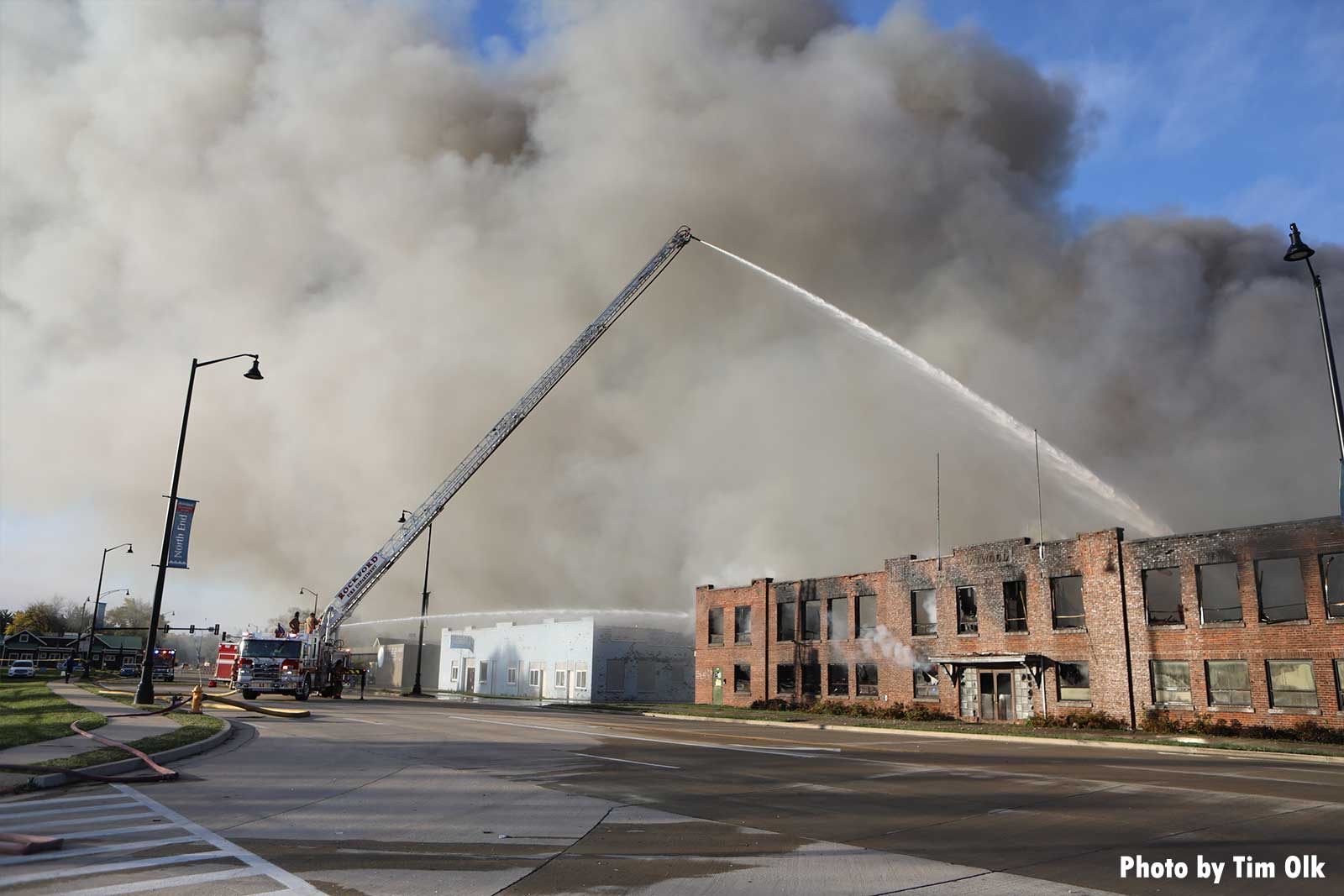 Aerial master stream with smoke from burning building