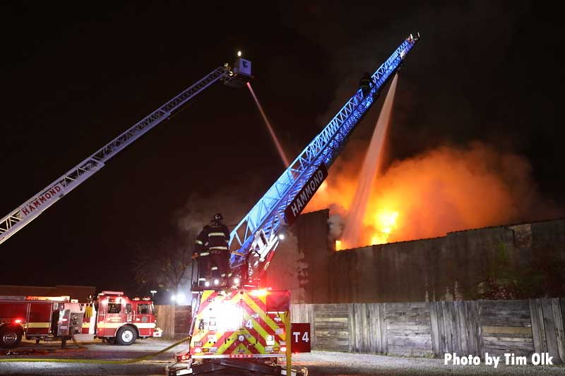 Firefighters with two aerials conducting water operations at fire