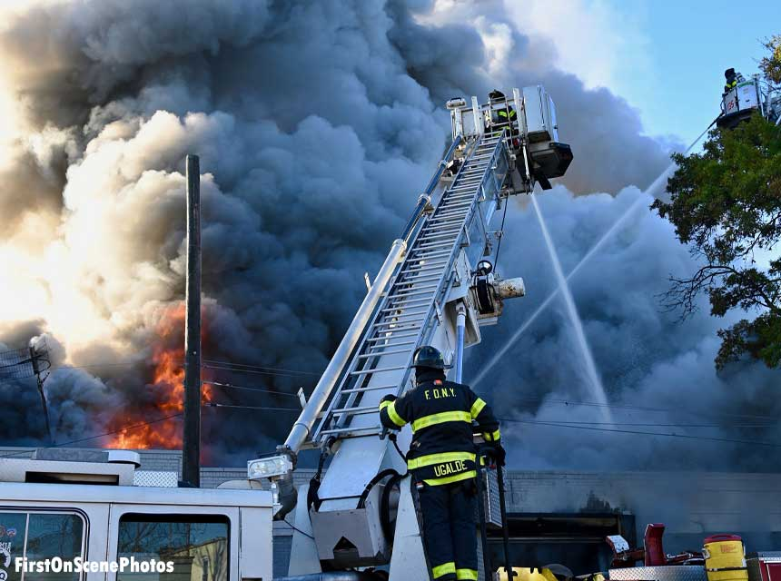 FDNY firefighter on tower ladder with master stream in use