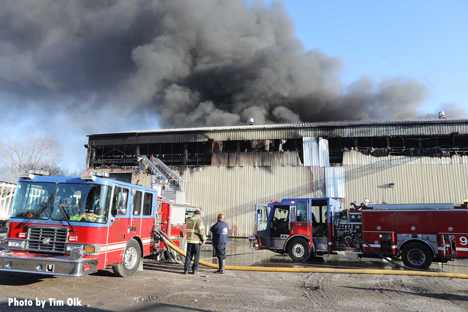 Fire trucks and smoke at industrial site