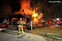 LAFD firefighters pull lines at a raging structure fire
