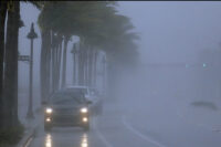 Cars move through tropical storm waters