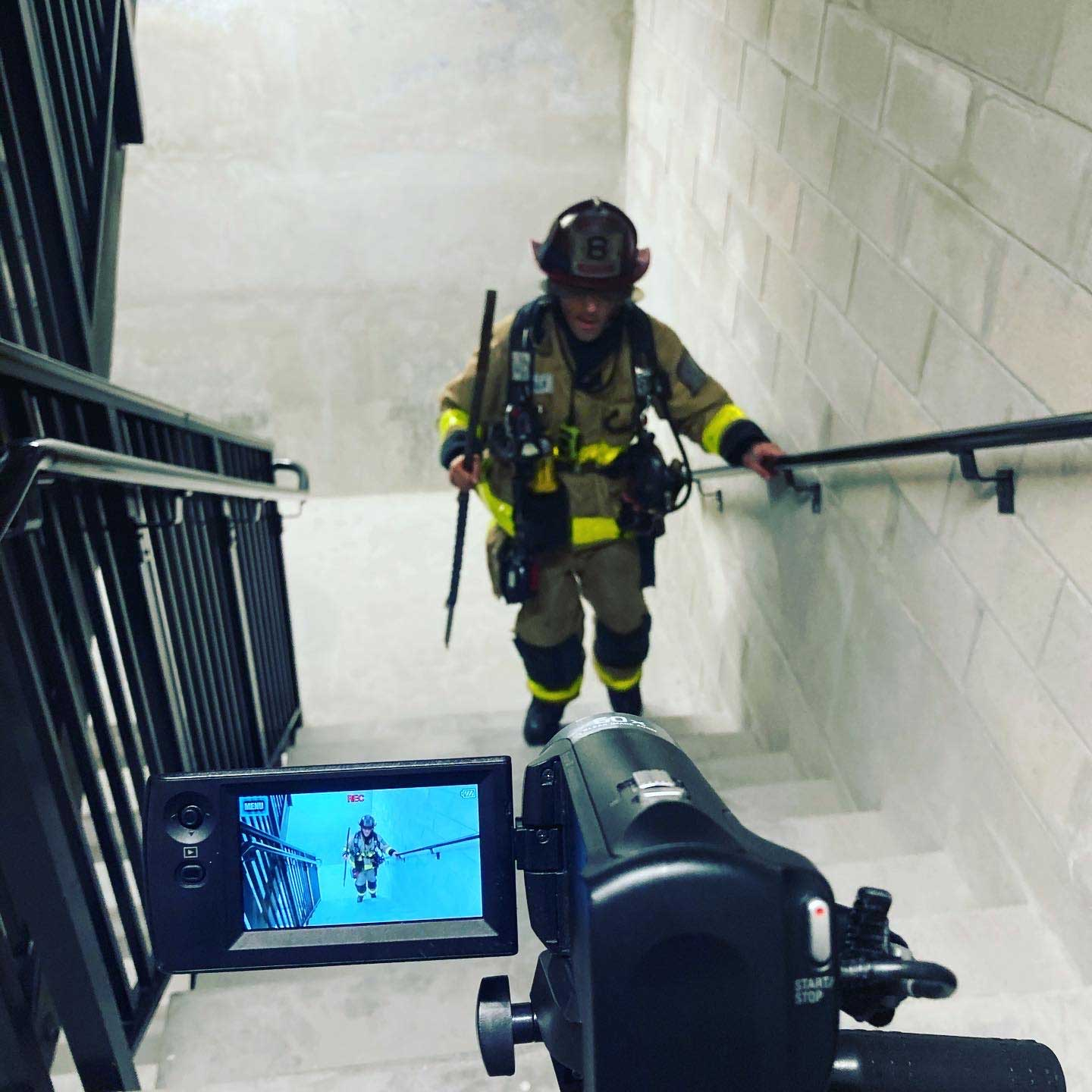Filming a firefighter on the stairs