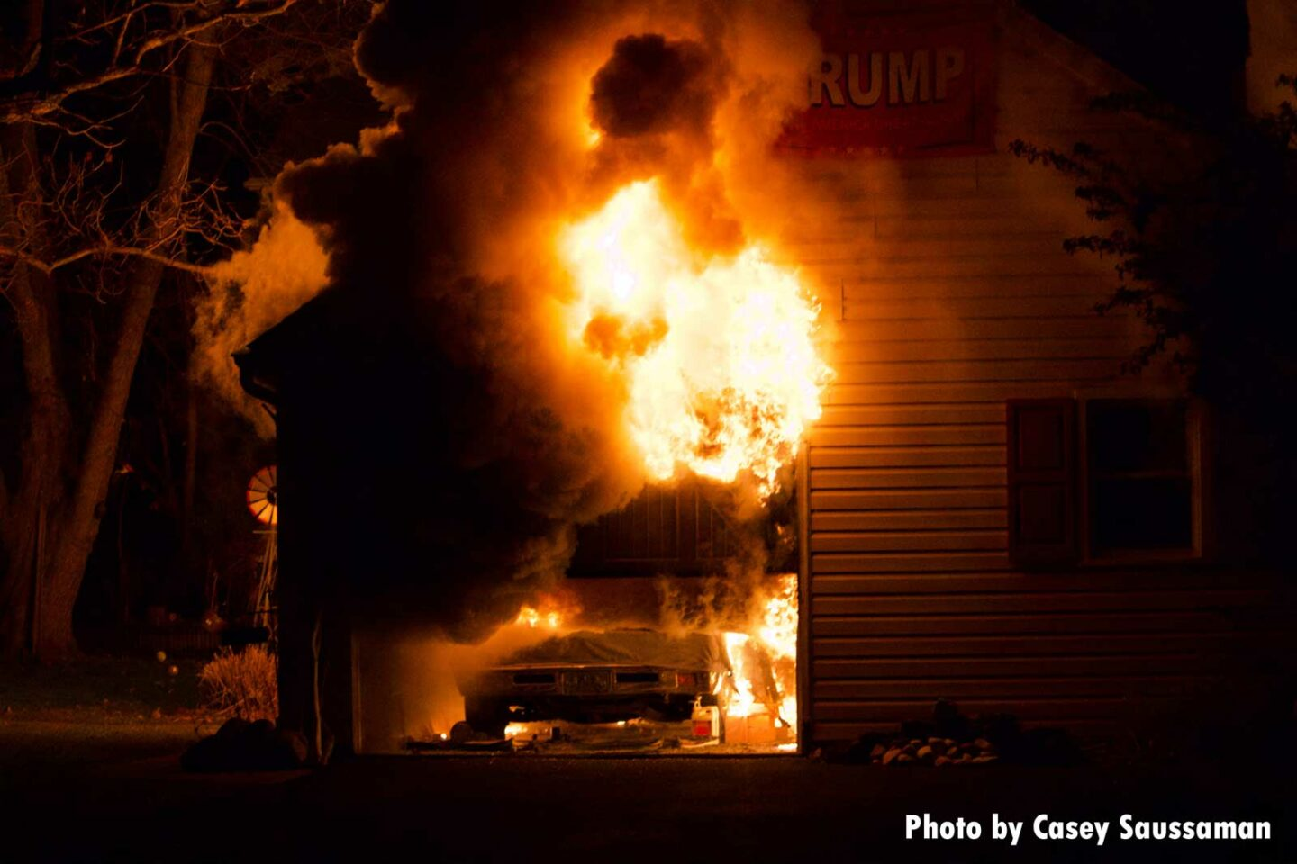 Photos show flames tearing through the garage and a vehicle