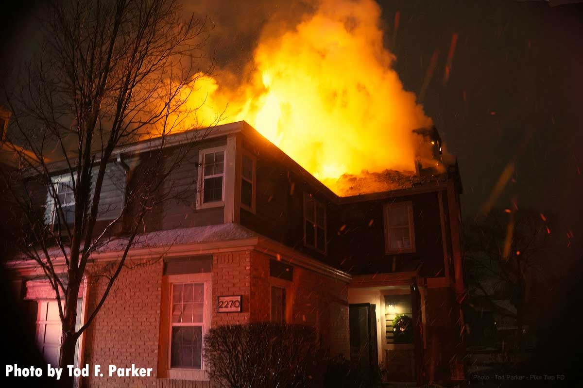 Flames erupt from the rear of the building