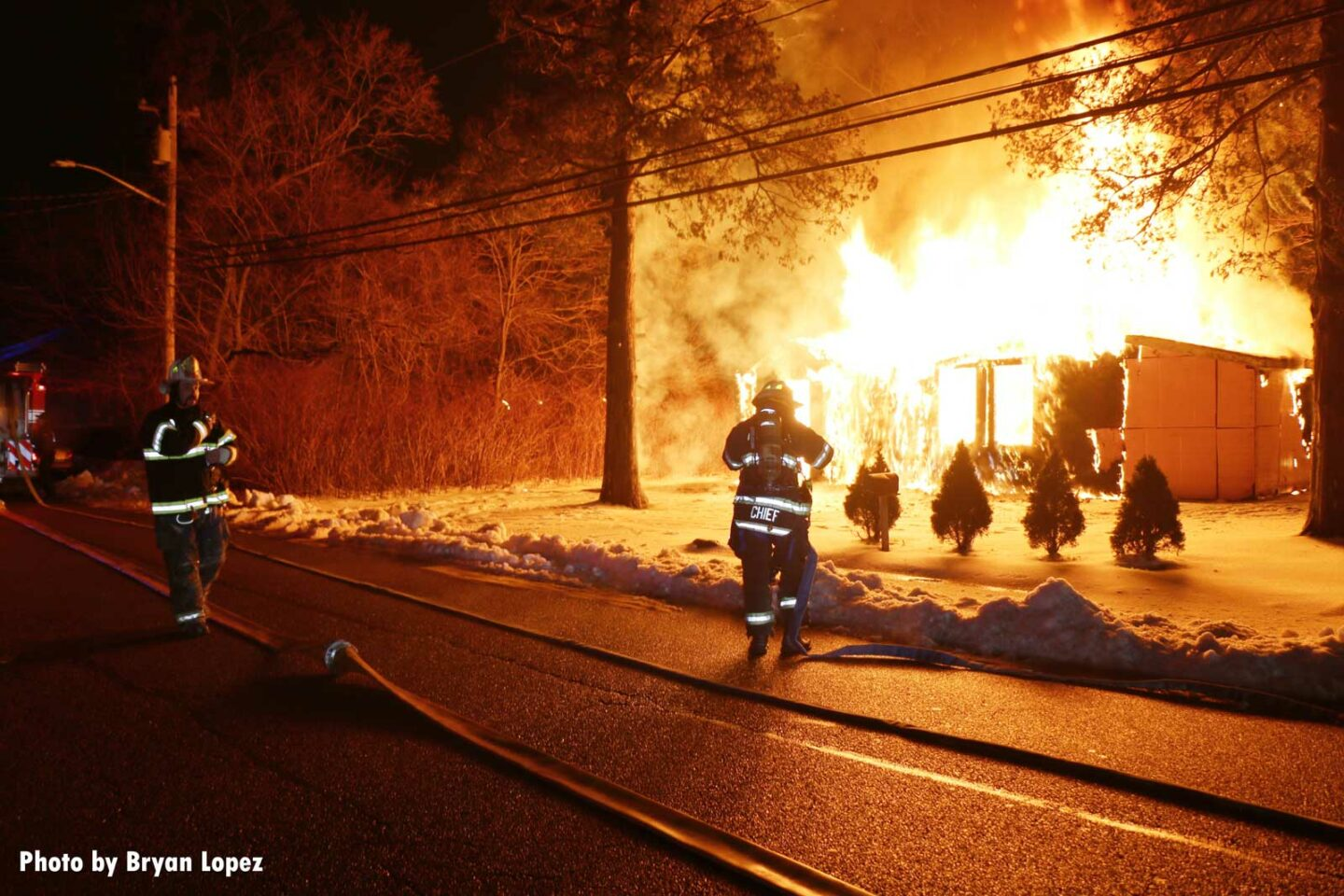 Firefighters begin to work at a fire in a vacant home