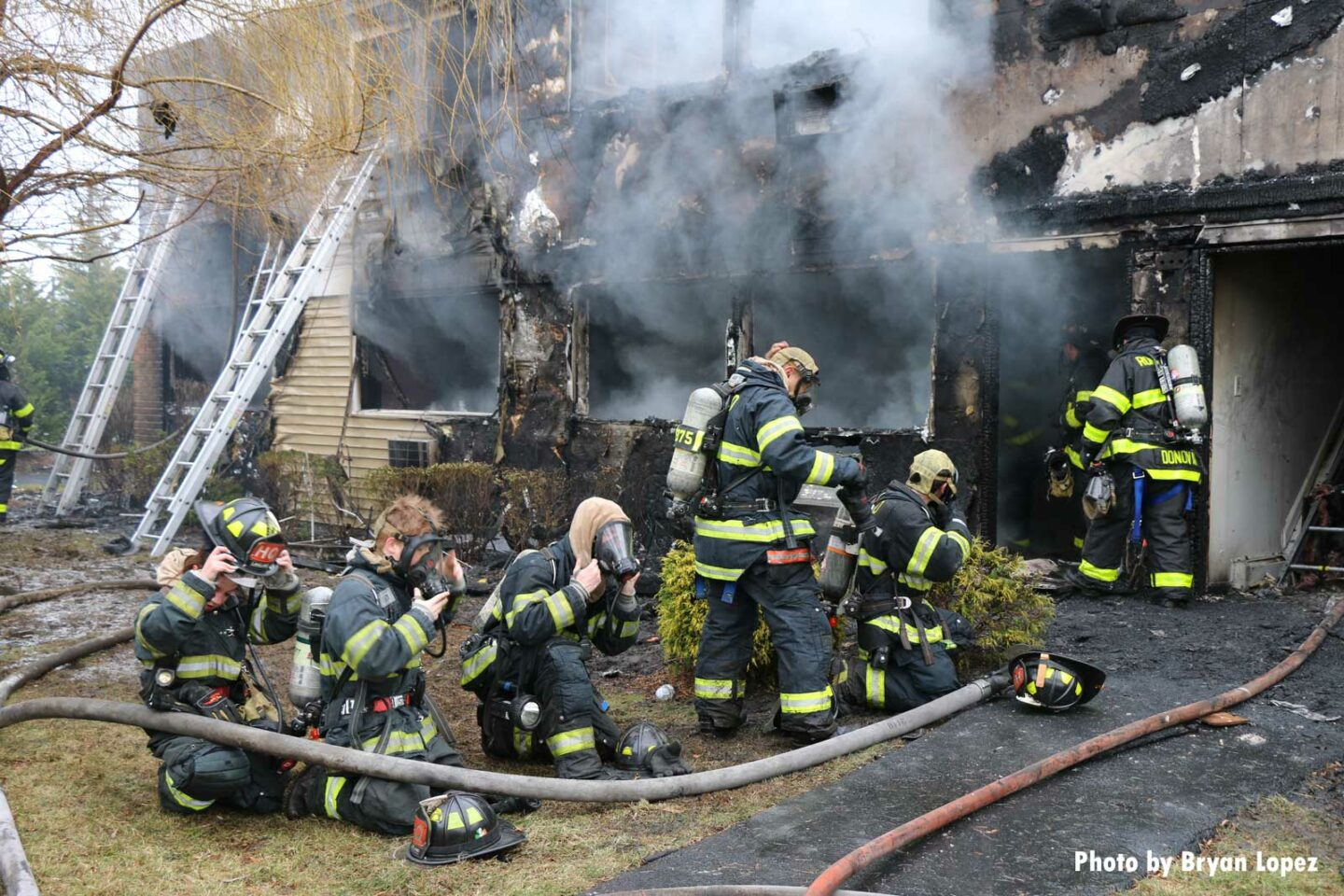 Firefighters at the scene of the Long Island house fire