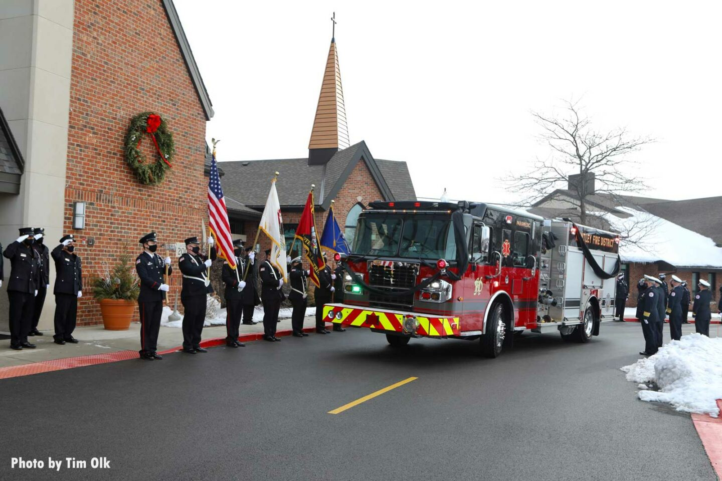 Fire apparatus arrives at services for Al Schlick