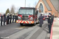 Firefighters salute rig at Al Schlick funeral